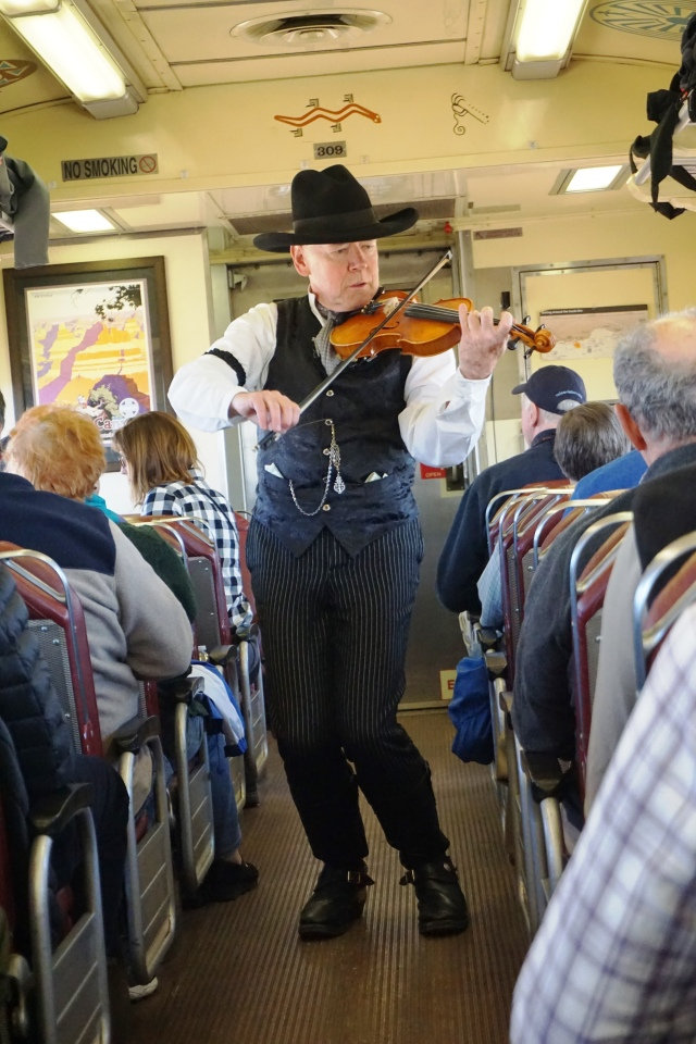 Fiddler-comic on the Grand Canyon Railway.JPG